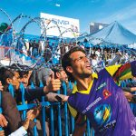 Mohammed Ibrahim taking a selfie with a fan's phone during a May 1 cricket match in Kabul, Afghanistan.  His side, the Terra Defenders, defeated the Pamir Riders.